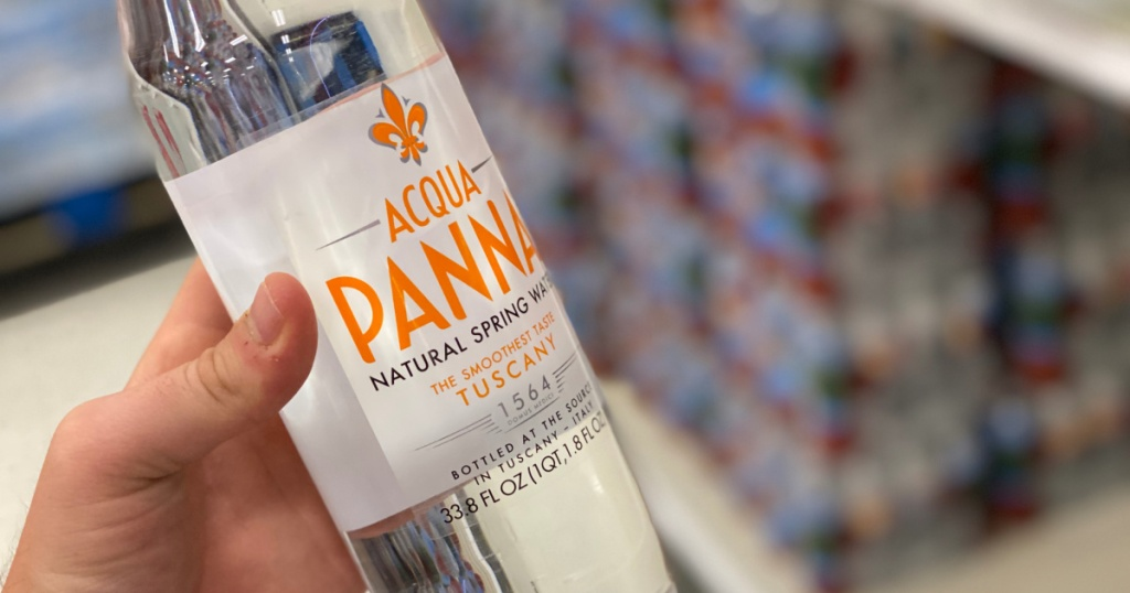 hand holding bottle of Acqua Panna Natural Spring Water in target
