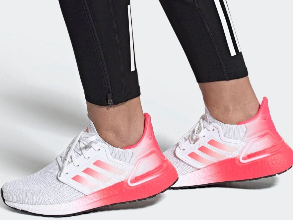 woman's feet wearing running shoes