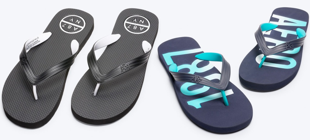 two pairs of mens flip flops in black and white and navy with light blue colors