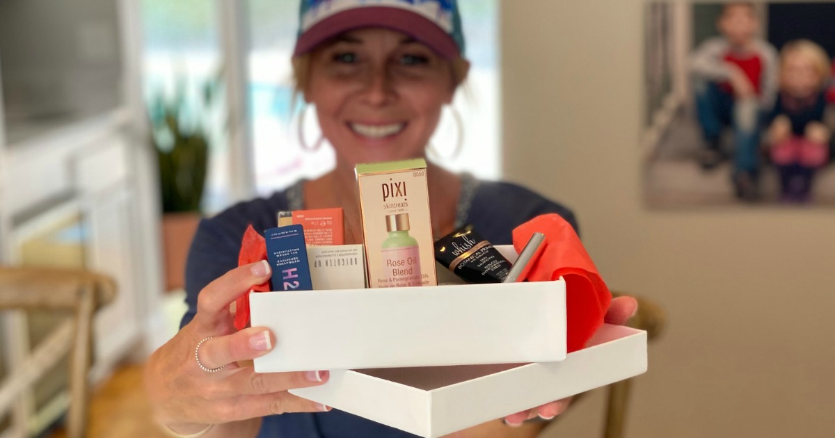 woman holding Allure box with beauty products