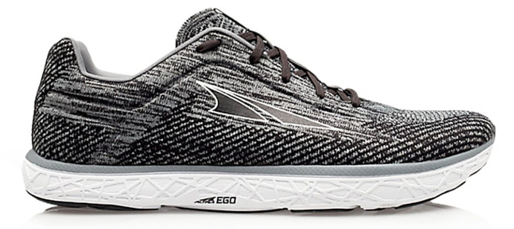 black and white knit running shoe with white rubber sole