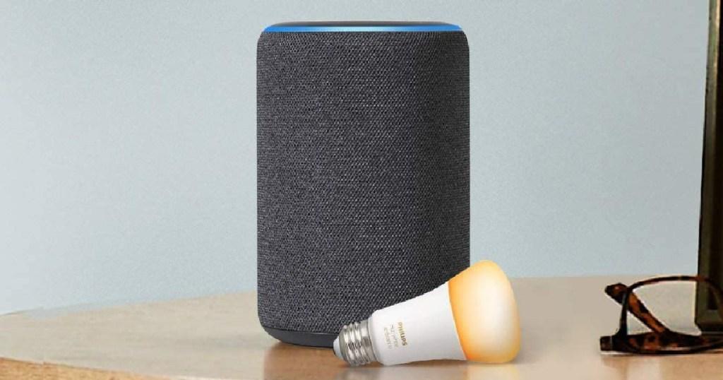 smart speaker, lightbulb, and glasses on table