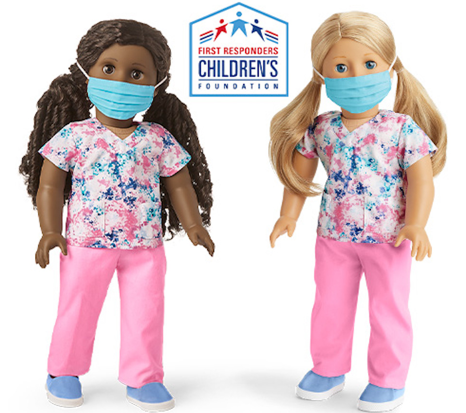 two American Girl dolls with masks and scrubs on
