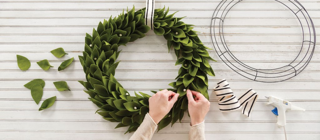 person crafting a wreath