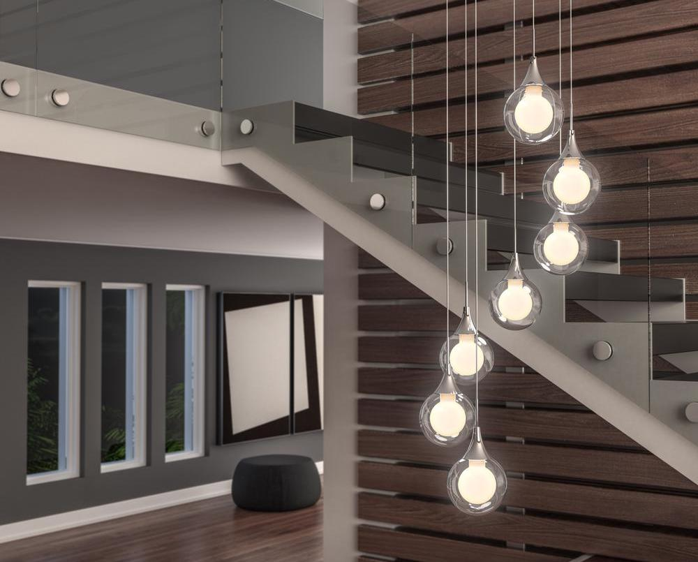 living room with globe lights by stairs