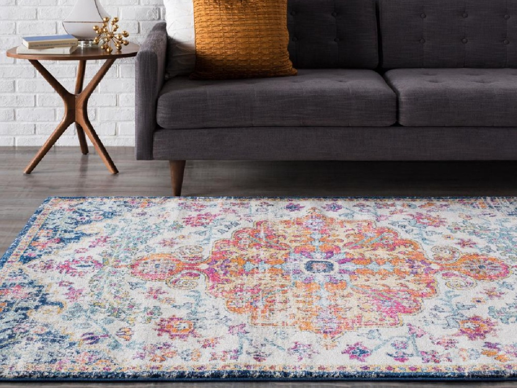multi-color oriental area rug in living room with couch and side table