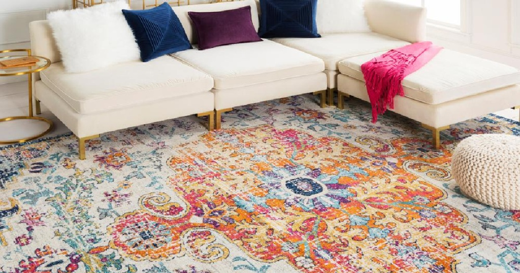 multi-color oriental area rug in living room with couch