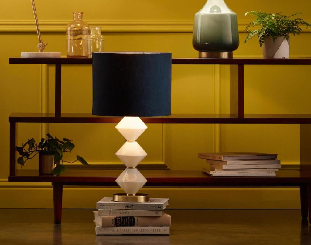 bookshelf with lamps and vases on it