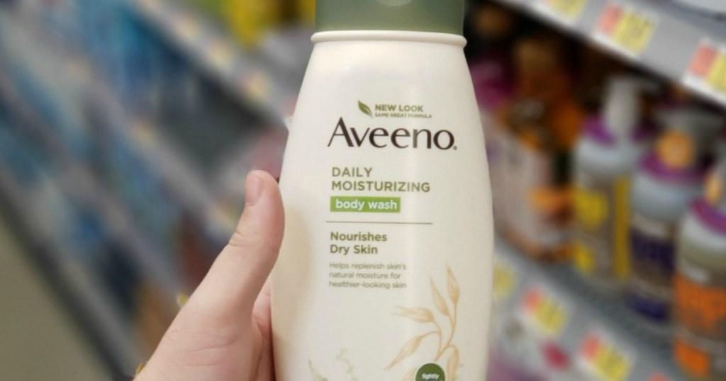 hand holding bottle of Aveeno Daily Moisturizing
