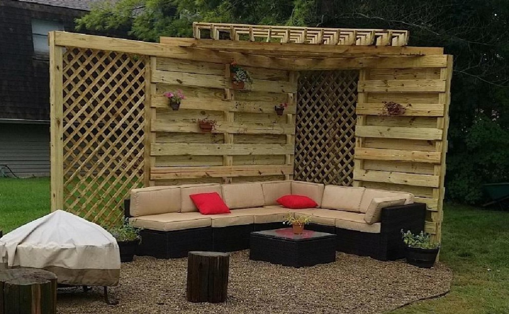tan and brown outdoor wicker furniture and red pillows