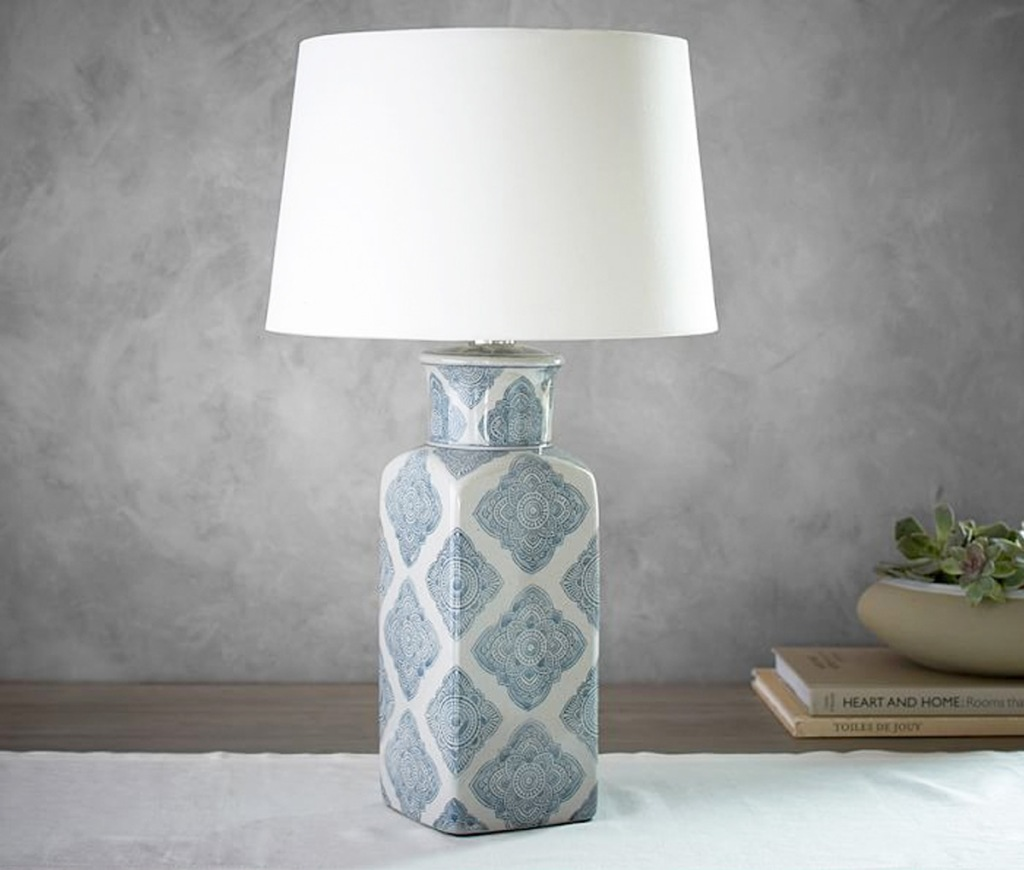 lamp with blue scallop print on case and white lamp shade
