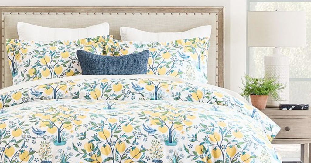 blue and yellow lemon print duvet cover on bed with matching pillow shams