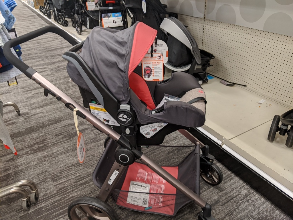 grey and pink Baby Trend Go Lite Snap Gear Sprout Travel System