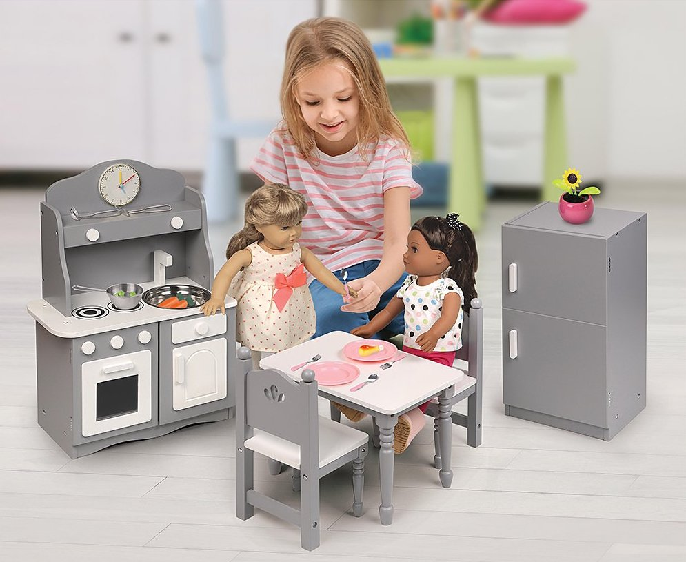 girl playing with doll in Badger Basket Kitchen