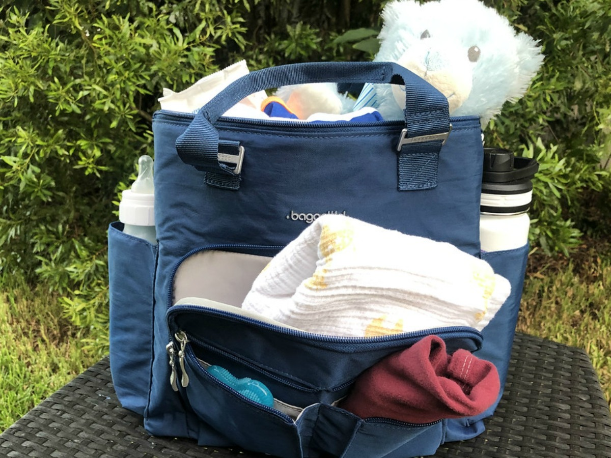 baggallini bag with baby stuff in it