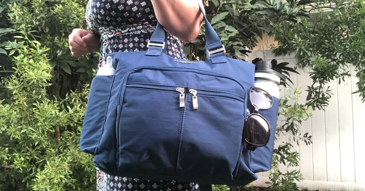 lady holding a blue Baggallini Bag