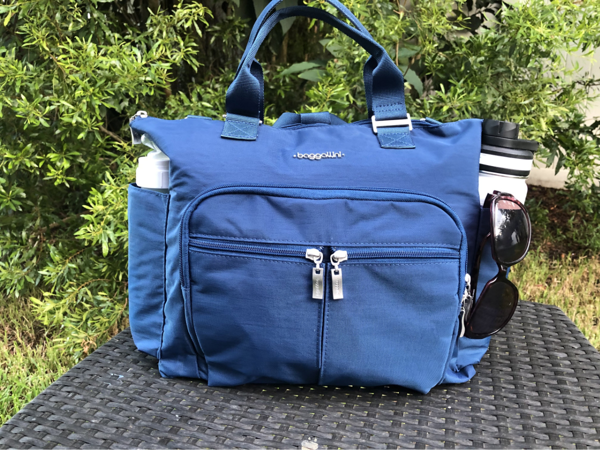blue Baggallini bag on table outdoors