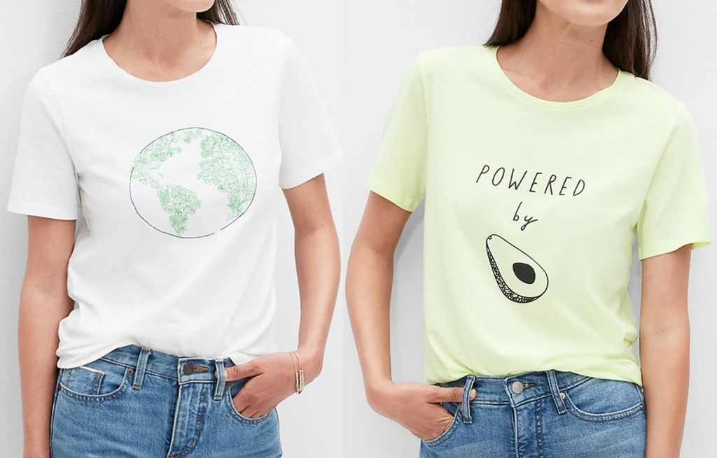 two women modeling graphic tees in white with globe print and light green with avocado print