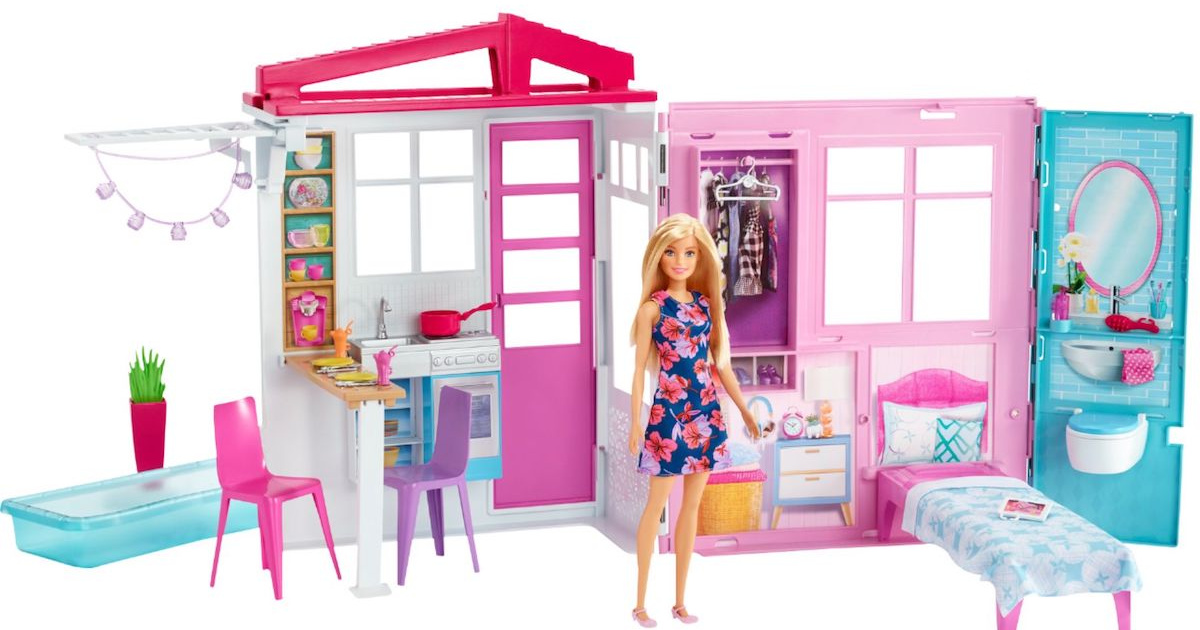 barbie doll standing with doll house open