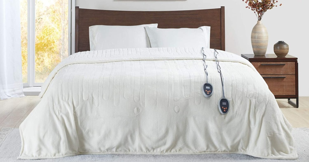 white electric blanket on bed