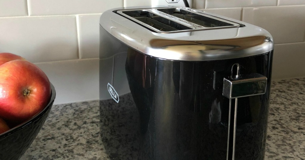 Bella toaster with bowl of apples next to it