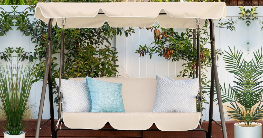 Best Choice Products 2 Person Canopy Swing with pillows sitting outside