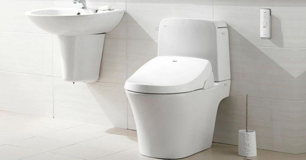 bidet in bathroom next to sink