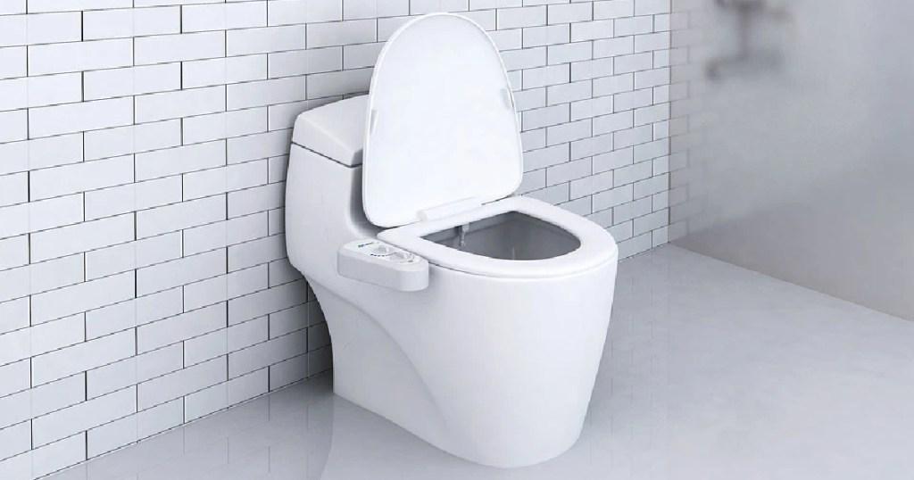 white bidet attachment on toilet in bathroom