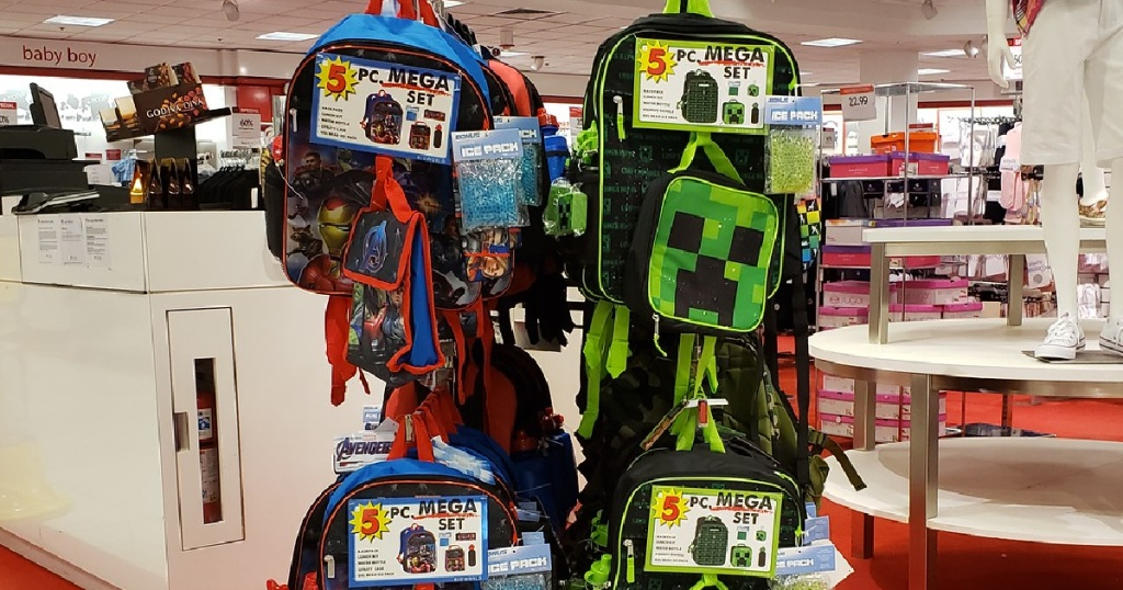 kids character backpack sets hanging in store