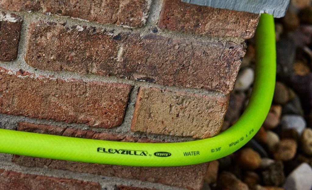 flexilla garden hose wrapped around brick corner