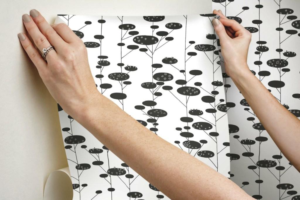 peel & stick wallpaper with hands