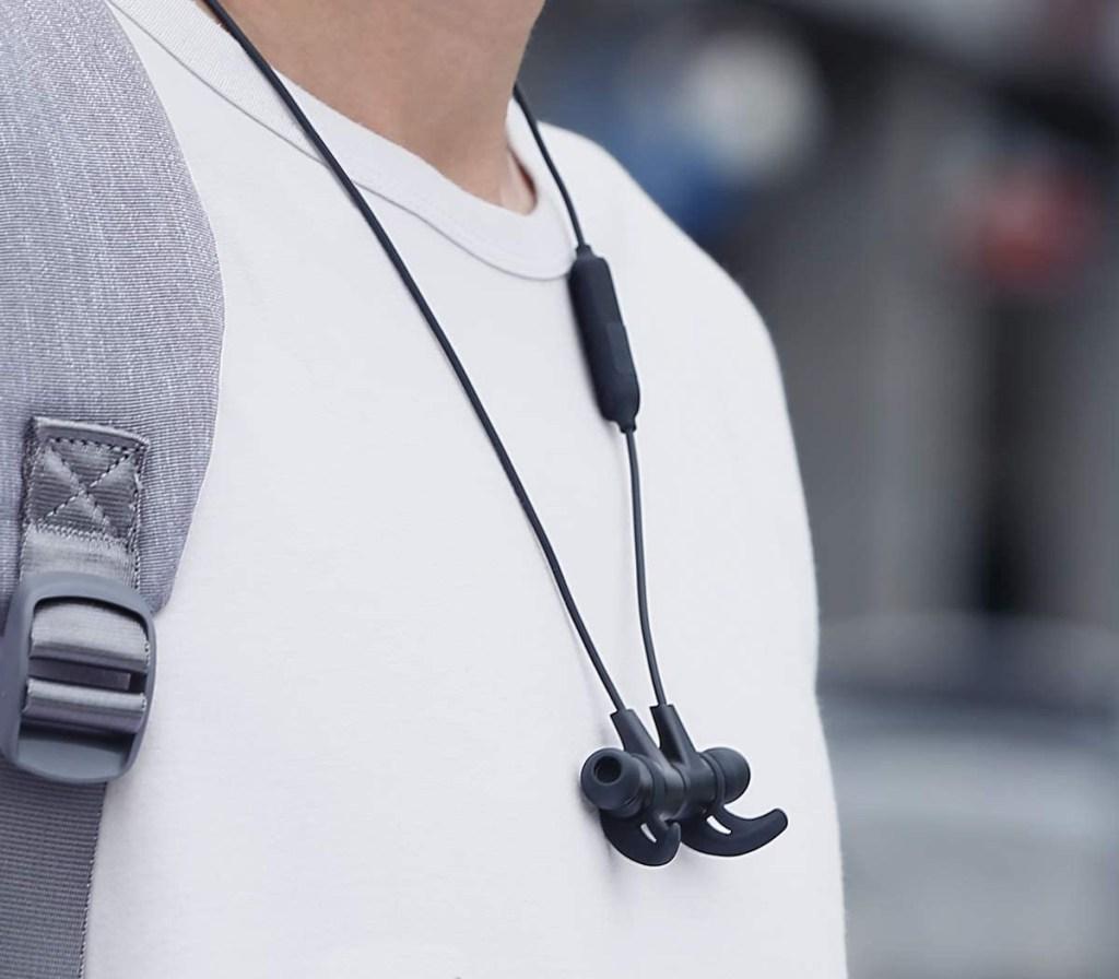 aukey wireless bluetooth headphones around neck