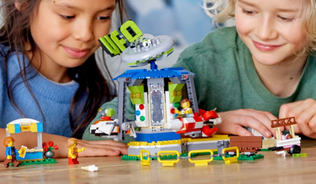 lego creator space-themed carousel with two kids playing