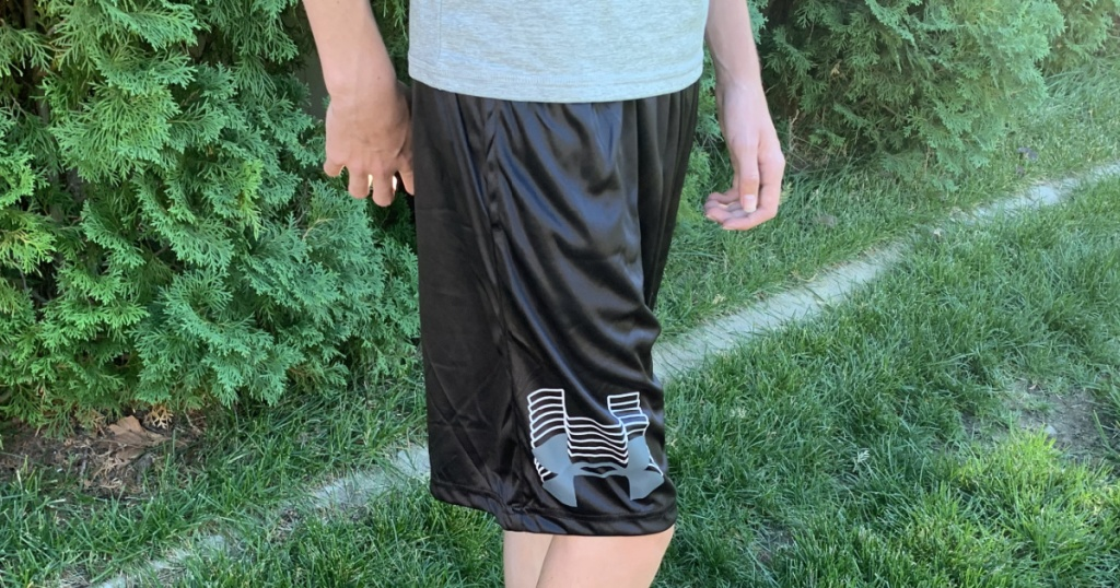 under armour boys prototype shorts in grass