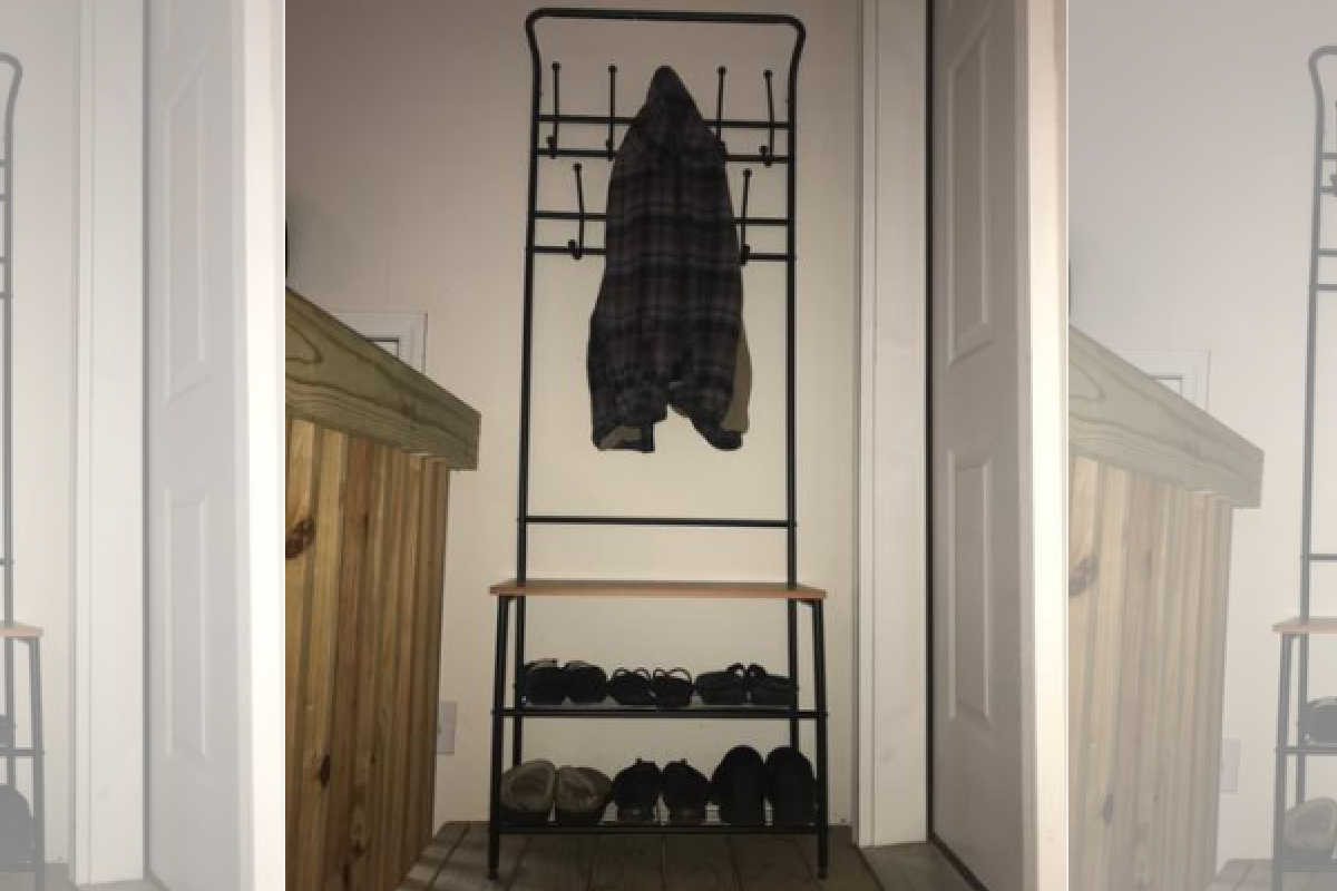 entryway table in home with coat on it