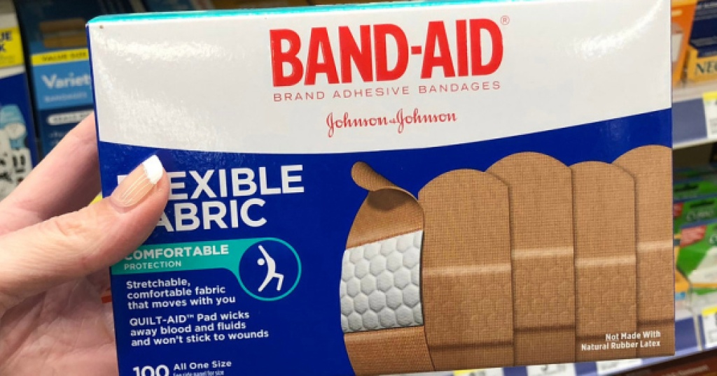 band aid flexible fabric bandages in box in hand