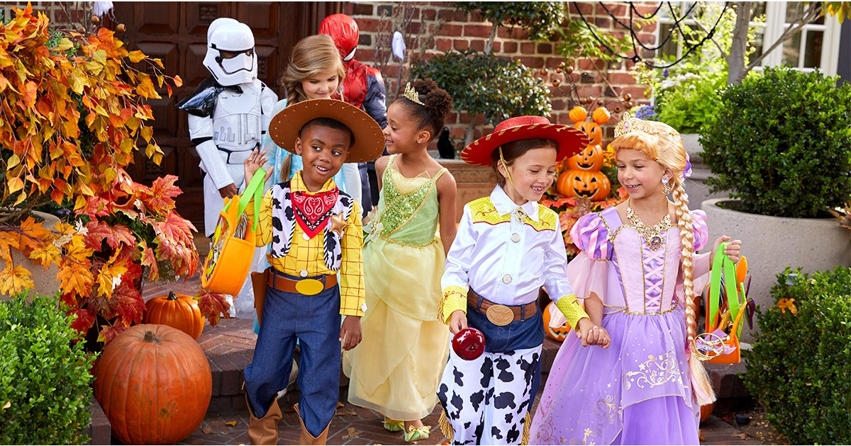 disney halloween costumes several kids dressed and trick or treating