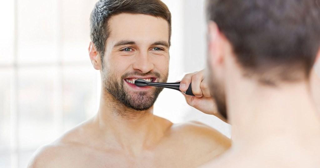 aqua sonic toothbrush man in mirror brushing teeth