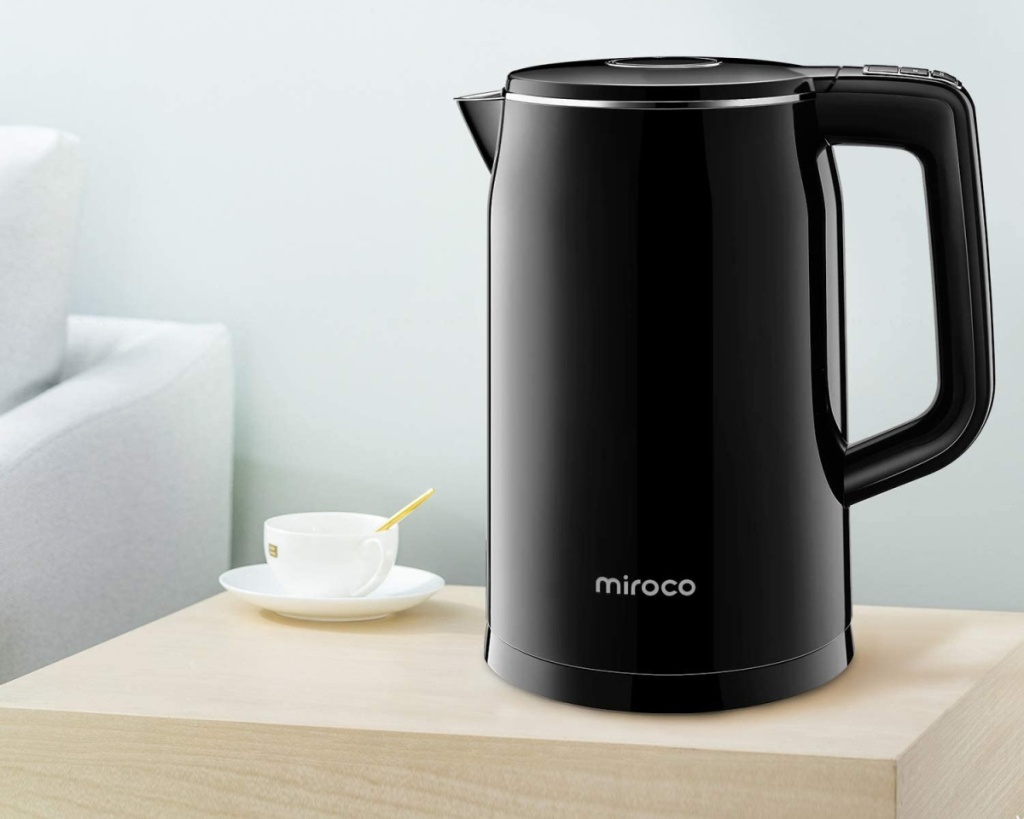 miroco electric kettle alone on counter next to teacup