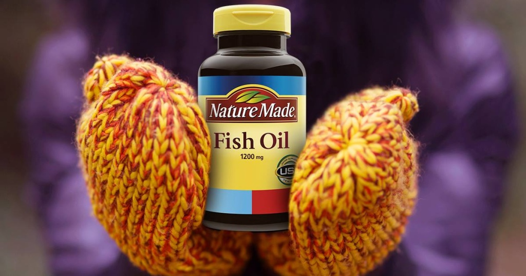 nature made fish oil held in mittens