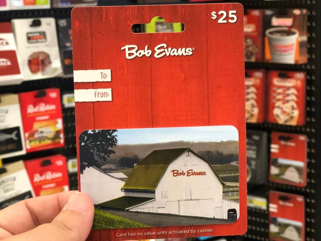 hand holding $25 Bob Evans gift cad