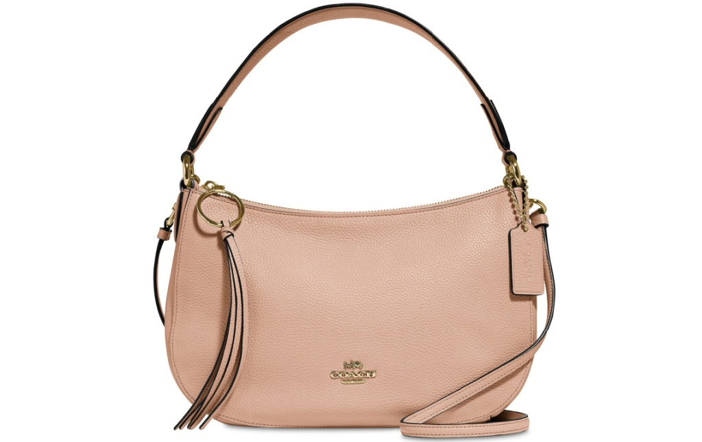 blush pink handbag with Coach monogram on front