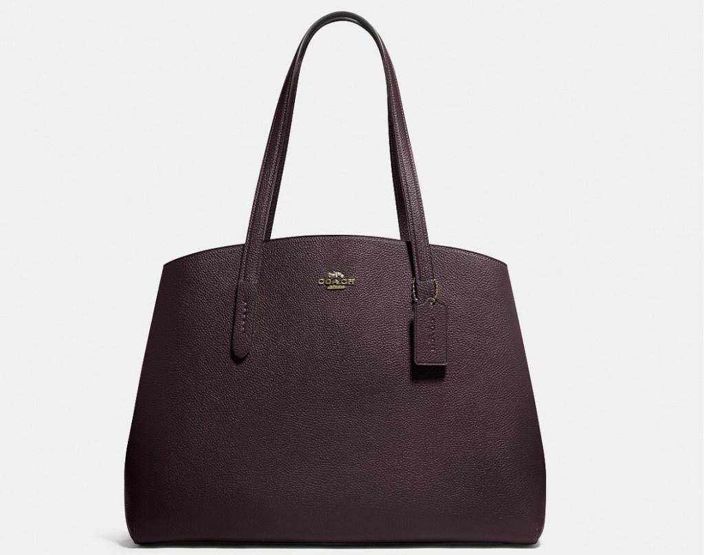 dark purple handbag with Coach monogram on front