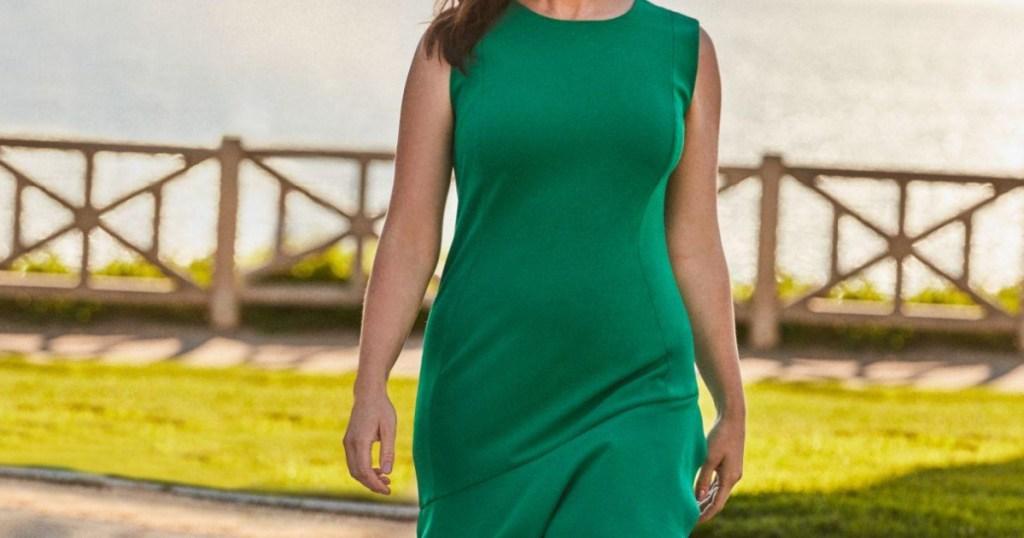 woman in green dress walking outdoors