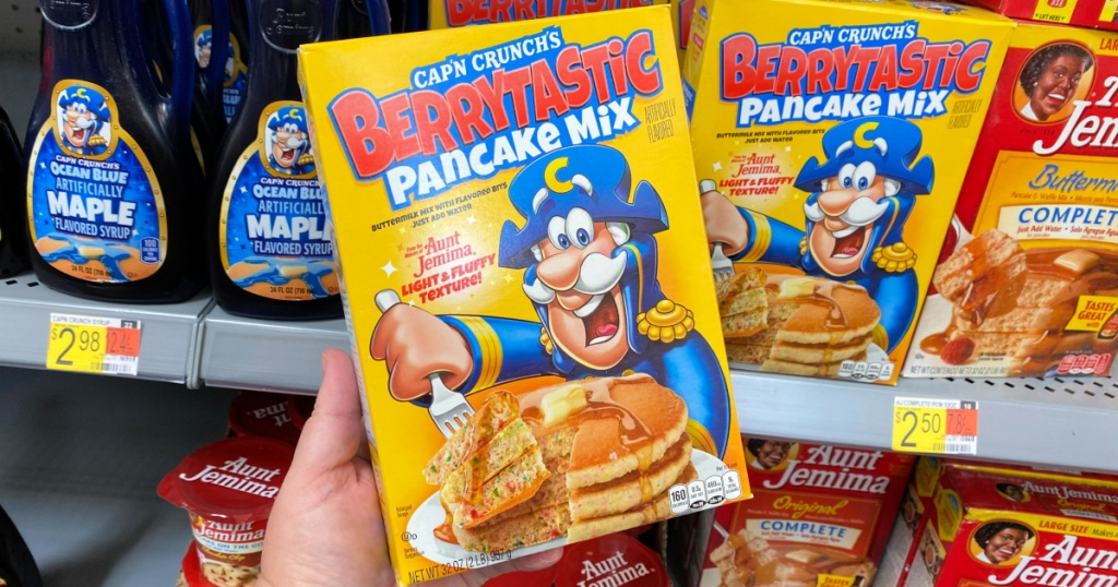Cap'N Crunch Berrytastic Pancake Mix in person's hand at Walmart