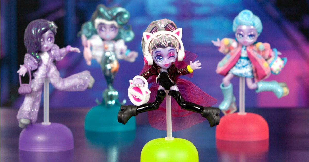 Capsule Chic Dolls on display stands