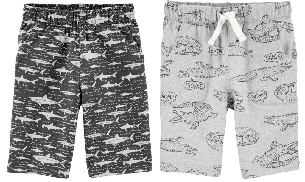 two pairs of Carter's boys shorts in grey with sharks and crocodile prints