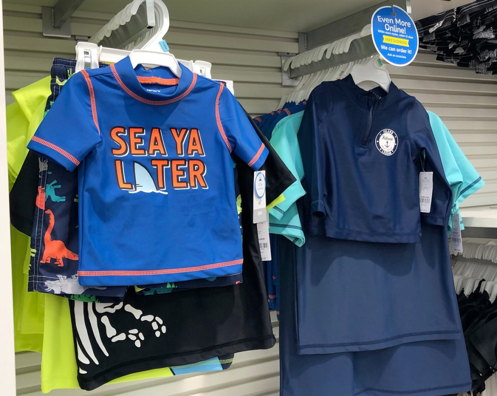 toddler boys swimwear on hangers hanging on carters store display racks