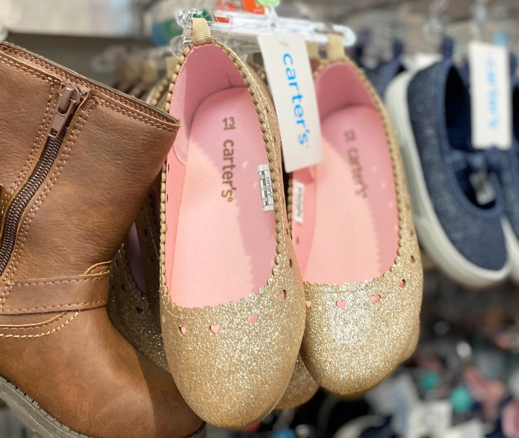 girls gold glitter ballet flats with pink interior and heart shaped cut outs along scalloped egdes