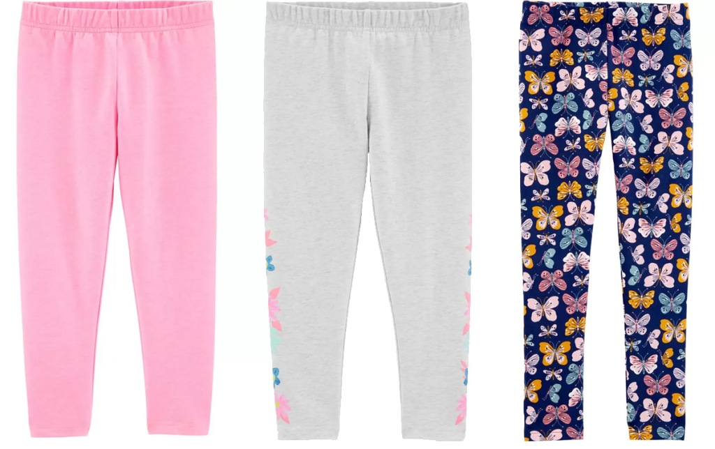 three pairs of Carter's girls leggings in solid pink, grey with flowers, and butterfly print
